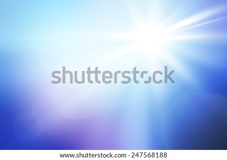Shining sun at clear blue sky and lens flare with copy space - stock photo