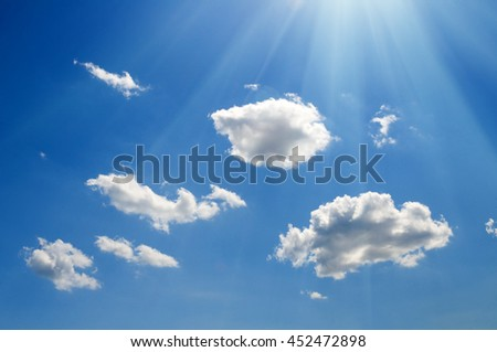 Shining sun at cloudy blue sky with copy space - stock photo
