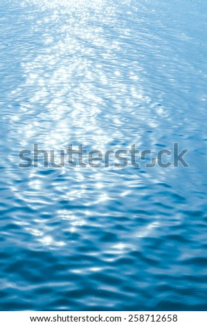 Shining water againts calm cold blue sunlight - stock photo