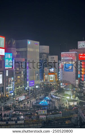 SHINJUKU, TOKYO - DECEMBER 21, 2014: Densely standing buildings in the North Western part of Shinjuku commercial district, one of the biggest and chaotic town in Japan. - stock photo