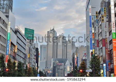 SHINJUKU, TOKYO - JULY 6: One of the biggest commercial area in Japan on July 6, 2013. About 800,000 people live and work here. Developed as a business district after the Great Kanto earthquake (1923) - stock photo