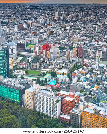 SHINJUKU, TOKYO - JUNE 29, 2014: Aerial view of western area of Shinjuku commercial and governmental district, from free observatory of Tokyo Metroplitan Government building at 45th floor.