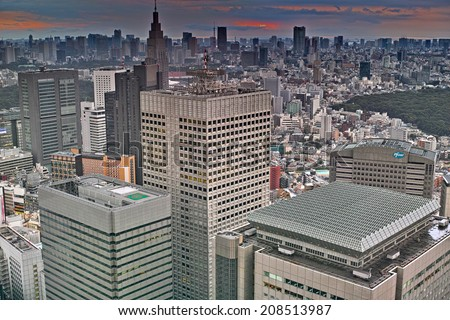 SHINJUKU, TOKYO - JUNE 29, 2014: Cityscape of western area of Shinjuku commercial and governmental district, the view from free observator of Tokyo Metroplitan Government building at 45th floor.