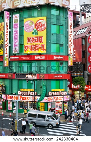SHINJUKU, TOKYO - MAY 31, 2014: Commercial building of Pachinko gambling and Slot machine arcade in Shinjuku, the biggest business, shopping, restaurnts and night life district in Japan. - stock photo