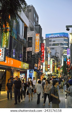 SHINJUKU, TOKYO - MAY 31, 2014: Crowd of people in Shinjuku, downtown Tokyo. About 800,000 people live and work here. The biggest commercial and night life town in Japan, called as sleepless city. - stock photo