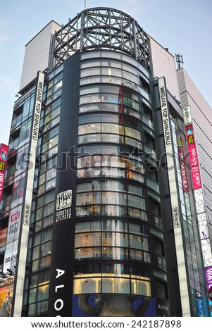 SHINJUKU, TOKYO - MAY 31, 2014: Glassed facade of commercial building in Shinjuku, the biggest business, shopping, restaurants and night life district in Japan. - stock photo