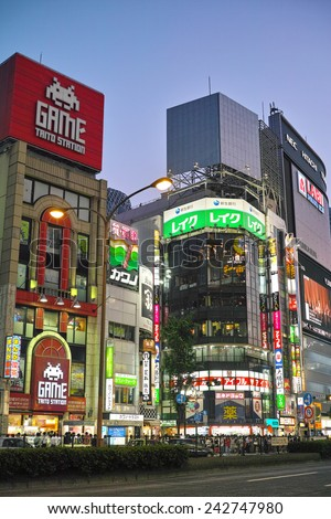 SHINJUKU, TOKYO - MAY 31, 2014: Illuminated commercial buildings, neon lights, billboards & restaurants in Shinjuku at night. One of the biggest & busiest commercial district in Japan.