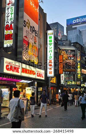 SHINJUKU, TOKYO - MAY 31, 2014: Night life at Shinjuku commercial district. Shinjuku is one of the biggest & busiest commercial and administrative area in Japan. - stock photo
