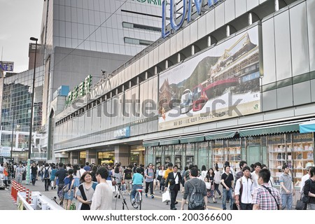 SHINJUKU, TOKYO - MAY 31: One of the biggest commercial area in Japan on May31, 2013. About 800,000 people live and work here. Developed as a business district after the Great Kanto earthquake (1923) - stock photo