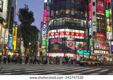 SHINJUKU, TOKYO - MAY 31, 2014: Street view of Shinjuku commercial district at night. A lot of people on the pedestrian crossing. - stock photo