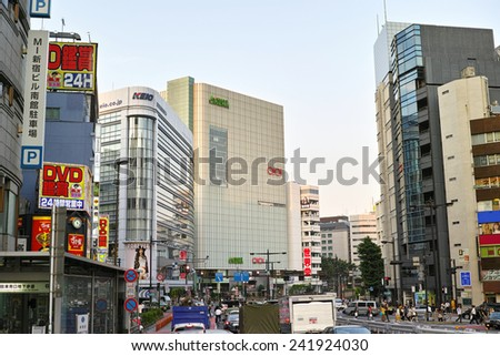 SHINJUKU, TOKYO - MAY 31, 2014: Street view of Shinjuku commercial district, one of the biggest and busiest town in Japan.