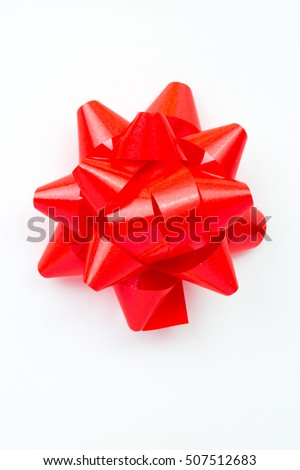 Shinny red gift ribbon bow on white background