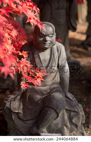 shinto/buddhist monk statues in the fall season, kyoto japan