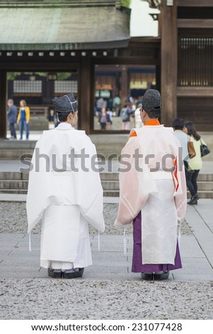 Shinto priests dressed for a wedding ceremony at the Meiji Shrine in Tokyo, Japan. - stock photo