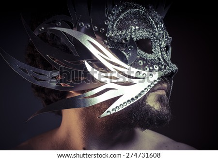 Shiny, bearded man with silver mask Venetian style. Mystery and renaissance - stock photo