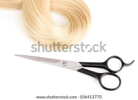 Shiny blond hair and hair cutting shears isolated on white