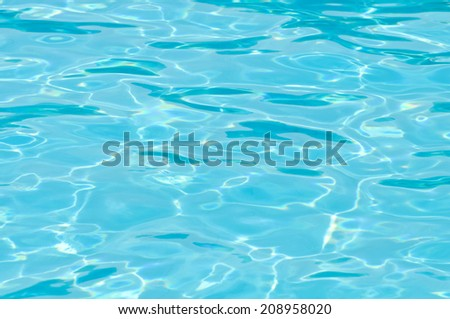 Shiny blue pool surface on a sunny summer day