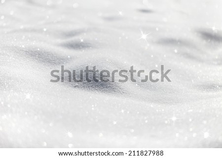 Shiny blurred snow background with sparkles (selective focus used).  - stock photo
