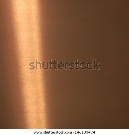 Shiny bronze surface background - stock photo