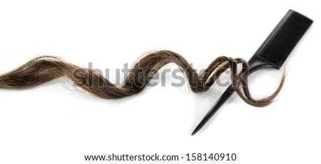 Shiny brown curl with comb isolated on white - stock photo
