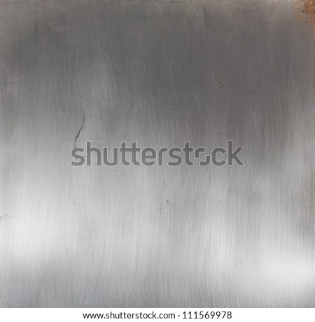 Shiny brushed silver metal surface - stock photo