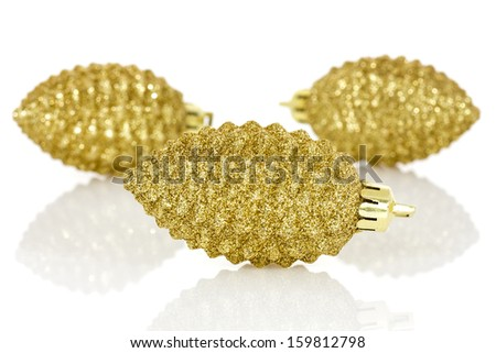 Shiny Christmas baubles golden pine cones on a white background
