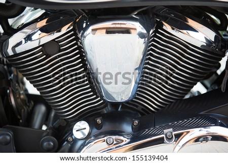 Shiny chromium-plated motorcycle engine closeup photo - stock photo