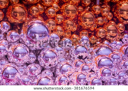 Shiny Colorful Christmas balls of themed purple and copper color baubles background in assorted sizes and shades in a full frame close up view - stock photo