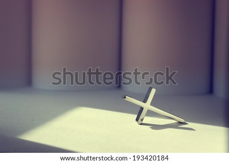 Shiny cross in vintage color. Religion Concept. - stock photo