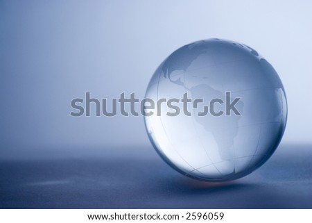 Shiny crystal globe in pale blue - stock photo
