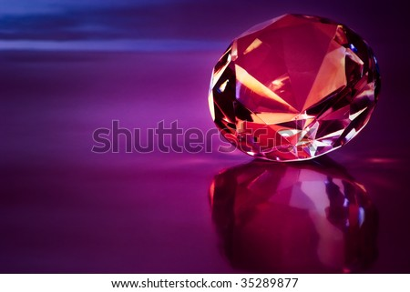 shiny diamond in purple light - stock photo