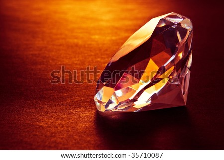 shiny diamond in warm light - stock photo