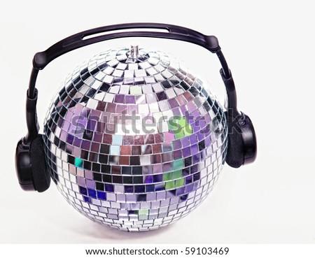 Shiny disco ball with headphones - stock photo
