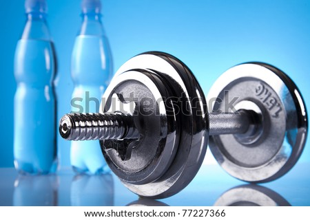 shiny dumbell and bottles of water