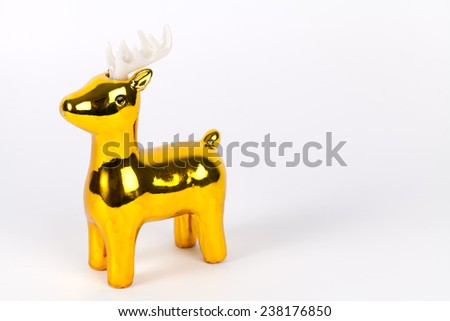 Shiny gold reindeer ornament with copy space, on white. - stock photo