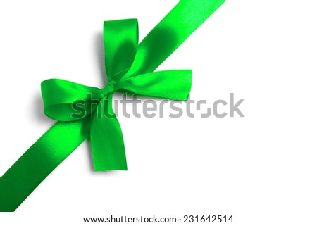 Shiny green satin ribbon on white background. studio shot - stock photo