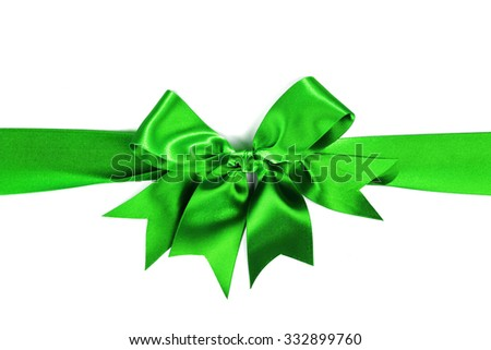 Shiny green satin ribbon with bow on white background - stock photo