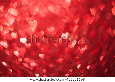 Shiny hearts bokeh light Valentine's day background - stock photo