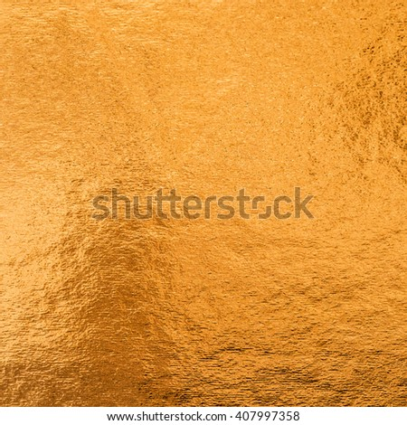 Shiny hot red copper brass bronze color decorative texture paper: Bright brilliant festive glossy metallic look textured empty wallpaper backdrop: Aluminium tin metal material craft design decoration - stock photo