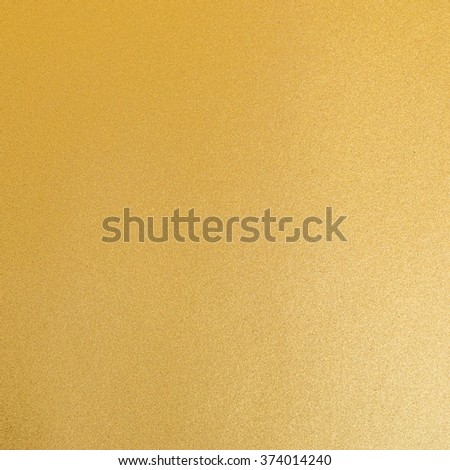Shiny hot yellow gold foil leaf decorative texture background: Crumpled bright brilliant festive glossy metallic look textured backdrop: Aluminium tin metal like material surface for design decoration - stock photo