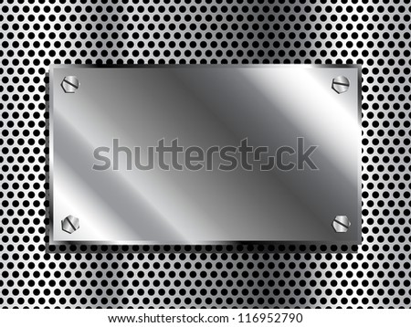 Shiny industrial looking metal plaque on grill background - stock photo