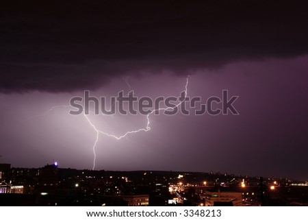 shiny lightning strike over the large city