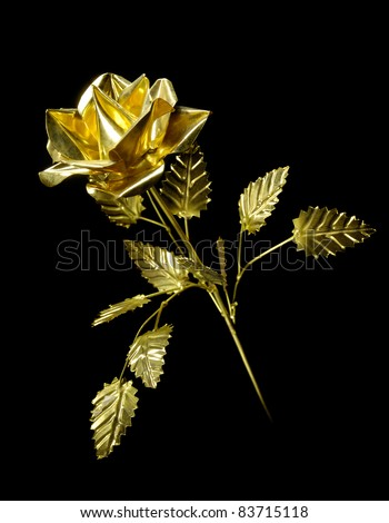 Shiny metal rose Flower made from brass Isolated on black background