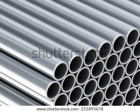 Shiny metal tubes stack industrial background - stock photo