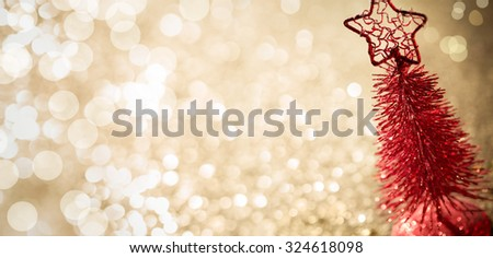 Shiny miniature tree on glitter background - stock photo