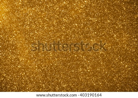 shiny particles gold background - stock photo
