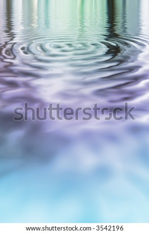 Shiny pastel blue purple and green metallic pool with ripples - stock photo