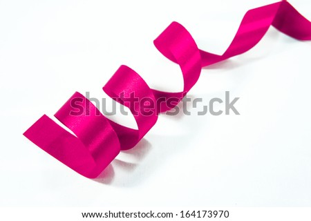 Shiny pink satin ribbon on white background with copy space. Macro with extremely shallow DOF. - stock photo