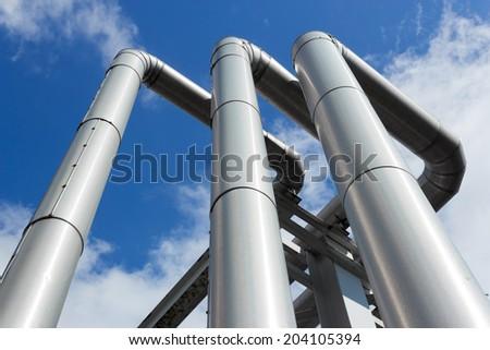 shiny pipeline under blue sky - stock photo