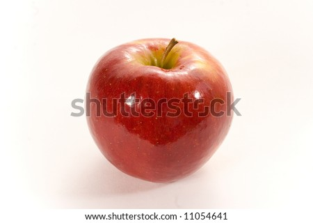 Shiny red apple close-up with clipping path isolated on white - stock photo